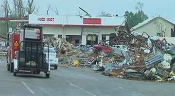 A brutal band of severe weather battered the central Plains and mid-South late Sunday, killing at least 16 people in Arkansas, one in Oklahoma and one in Iowa. By Brendan Marks