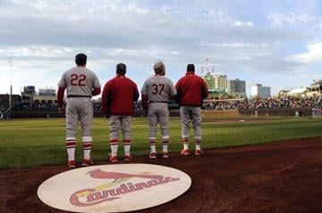 CHICAGO, IL - MAY 04: The St. Louis Cardinals stand during the national anthem before the game against the Chicago Cubs on May 4, 2014 at Wrigley Field in Chicago, Illinois. (Photo by David Banks/Getty Images) By David Banks