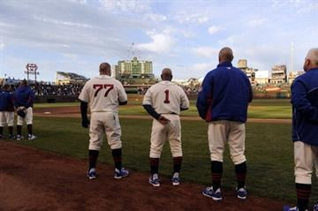 CHICAGO, IL - MAY 04: The Chicago Cubs stand during the national anthem before the game against the St. Louis Cardinals on May 4, 2014 at Wrigley Field in Chicago, Illinois. (Photo by David Banks/Getty Images) By David Banks