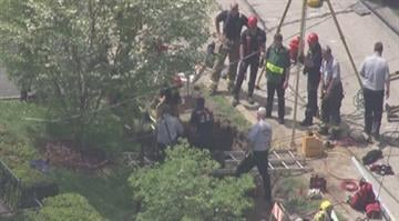 More than a dozen workers were helping rescue a person who got trapped inside a trench in Brentwood on Monday. By Brendan Marks