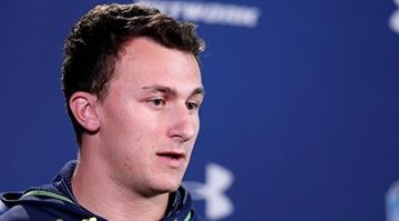 INDIANAPOLIS, IN - FEBRUARY 21: Former Texas A&M quarterback Johnny Manziel speaks to the media during the 2014 NFL Combine at Lucas Oil Stadium on February 21, 2014 in Indianapolis, Indiana. (Photo by Joe Robbins/Getty Images) By Joe Robbins