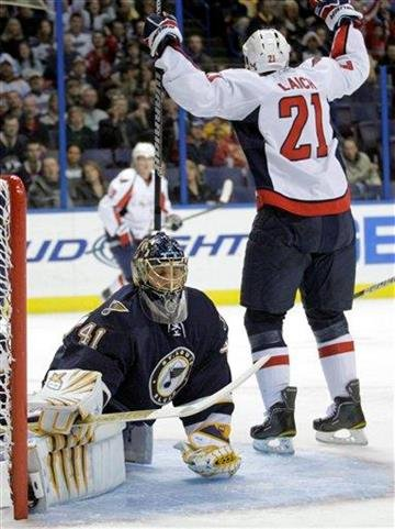 Washington Capitals' Brooks Laich (21) celebrates a goal as St. Louis Blues' Jaroslav Halak, of Slovakia, reacts in the first period of an NHL hockey game, Wednesday, Dec. 1, 2010 in St. Louis. (AP Photo/Tom Gannam) By Tom Gannam