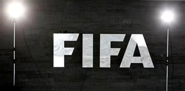 Two lamps shine next to the FIFA sign at the FIFA headquarters in Zurich, Switzerland, Thursday, Dec. 2, 2010. FIFA will announce the 2018 and 2022 Soccer World Cup hosts later the day. (AP Photo/Michael Probst) By Michael Probst