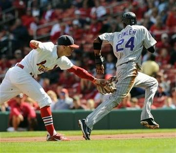 Colorado Rockies' Dexter Fowler (24) is tagged out by St. Louis Cardinals' Brendan Ryan, left, during a rundown in the first inning in a baseball game Sunday, Oct. 3, 2010, in St. Louis. (AP Photo/Bill Boyce) By Bill Boyce