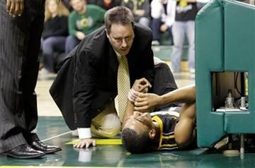 Missouri guard Phil Pressey is assisted after being fouled in the second half of their NCAA college basketball game Thursday, Dec. 2, 2010, in Eugene, Ore. Missouri defeated Oregon 83-80. (AP Photo/Rick Bowmer) By Rick Bowmer