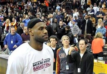 LeBron James of the Miami Heat walks off the court after the Heat defeated the Cleveland Cavaliers 118-90 in an NBA basketball game Thursday, Dec. 2, 2010, in Cleveland. (AP Photo/David Richard) By David Richard