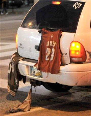A Lebron James shirt hangs on a vehicle as it drives by the arena before the Miami Heat play the Cleveland Cavaliers in an NBA basketball game Thursday, Dec. 2, 2010, in Cleveland. (AP Photo/David Richard) By David Richard