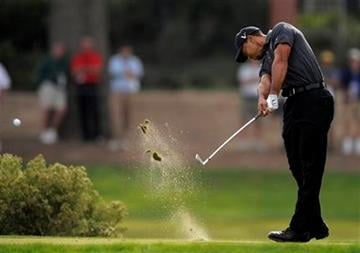 Tiger Woods tees off on the third hole during the second round of the Chevron World Challenge golf tournament at Sherwood Country Club, Friday, Dec. 3, 2010, in Thousand Oaks, Calif. (AP Photo/Mark J. Terrill) By Mark J. Terrill