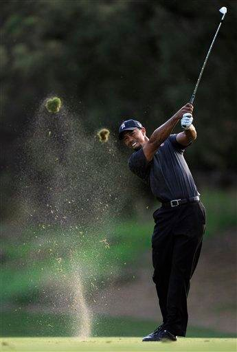 Tiger Woods makes his approach shot on the 18th hole during the second round of the Chevron World Challenge golf tournament at Sherwood Country Club, Friday, Dec. 3, 2010, in Thousand Oaks, Calif. (AP Photo/Mark J. Terrill) By Mark J. Terrill