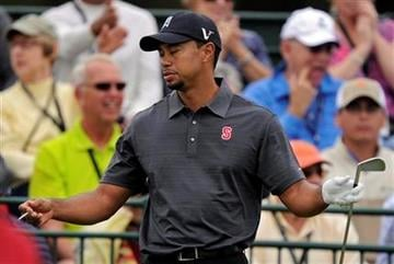 Tiger Woods reacts to his tee shot on the first hole during the second round of the Chevron World Challenge golf tournament at Sherwood Country Club, Friday, Dec. 3, 2010, in Thousand Oaks, Calif.   (AP Photo/Mark J. Terrill) By Mark J. Terrill