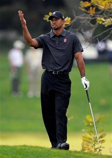 Tiger Woods reacts to his tee shot on the third hole during the second round of the Chevron World Challenge golf tournament at Sherwood Country Club, Friday, Dec. 3, 2010, in Thousand Oaks, Calif.   (AP Photo/Mark J. Terrill) By Mark J. Terrill