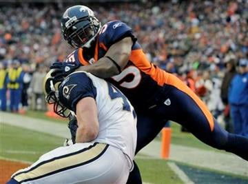 St. Louis Rams tight end Billy Bajema (47) catches a touchdown-pass against the Denver Broncos linebacker D.J. Williams (55) during the second quarter of an NFL football game Sunday, Nov. 28, 2010, in Denver. (AP Photo/Joe Mahoney) By Joe Mahoney