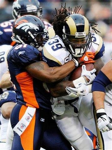 St. Louis Rams running back Steven Jackson (39) is tackled by Denver Broncos linebacker Joe Mays (51) during the first half of an NFL football game Sunday, Nov. 28, 2010, in Denver. (AP Photo/Chris Schneider) By Chris Schneider
