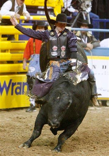 Steve Woolsey competes in the bull riding competition during the first go-round of National Finals Rodeo Thursday, Dec. 2, 2010, in Las Vegas. (AP Photo/Isaac Brekken) By Isaac Brekken