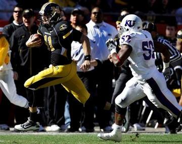 Missouri quarterback Blaine Gabbert (11) gets past Kansas linebacker Steven Johnson (52) during the first half of their NCAA college football game at Arrowhead Stadium in Kansas City, Mo., Saturday, Nov. 27, 2010. (AP Photo/Orlin Wagner) By Orlin Wagner