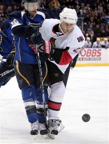 St. Louis Blues' Andy McDonald, left, and Ottawa Senators' Alexei Kovalev, of Russia, chase a loose puck during the first period of an NHL hockey game Friday, Nov. 19, 2010, in St. Louis. (AP Photo/Jeff Roberson) By Jeff Roberson