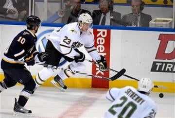 Dallas Stars center Tom Wandell (23), of Sweden, advances the puck against St. Louis Blues center Andy McDonald (10) during the third period of an NHL hockey game, Saturday, Nov. 27, 2010, in St. Louis. (AP Photo/Sid Hastings) By Sid Hastings