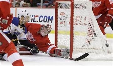 St. Louis Blues winger Andy McDonald (10) scores on Detroit Red Wings goalie Jimmy Howard during the second period of an NHL hockey game in Detroit, Wednesday, Nov. 17, 2010. (AP Photo/Carlos Osorio) By Carlos Osorio