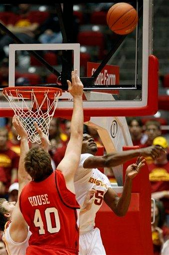 Iowa State forward Calvin Godfrey, right, blocks a shot by Southeast Missouri State center Zach House during the first half of an NCAA college basketball game, Monday, Dec. 6, 2010, in Ames, Iowa. (AP Photo/Charlie Neibergall) By Charlie Neibergall