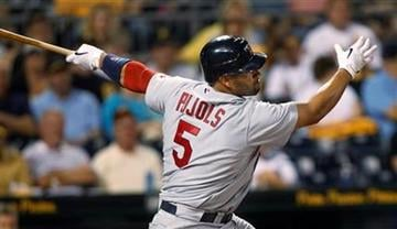 St. Louis Cardinals' Albert Pujols strikes out swinging in the third inning of a baseball game against the Pittsburgh Pirates in Pittsburgh, Wednesday, Sept. 22, 2010. (AP Photo/Keith Srakocic) By Keith Srakocic