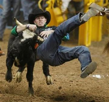 Josh Peek competes in the steer wrestling competition during the third go-round of National Finals Rodeo Saturday, Dec. 4, 2010, in Las Vegas. (AP Photo/Isaac Brekken) By Isaac Brekken