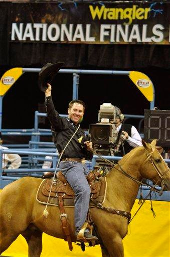 Trevor Brazile acknowledges the crowd after clinching first place during the second go-round of National Finals Rodeo, Friday, Dec. 3, 2010 in Las Vegas. (AP Photo/Mark Damon) By Mark Damon