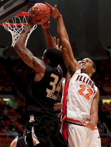 Illinois forward Jereme Richmond (22) moves to block a shot by Oakland (Mich.) center Keith Benson (34) during the second half of ab NCAA college basketball game Wednesday, Dec. 8, 2010, in Champaign, Ill. (AP Photo/Darrell Hoemann) By Darrell Hoemann