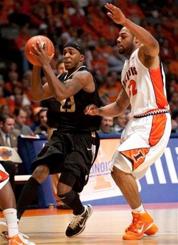 Oakland, Mich., guard Reggie Hamilton (23) tries to pass as Illinois guard Demetri McCamey (32) defends during the second half of an NCAA college basketball game on Wednesday, Dec. 8, 2010, in Champaign, Ill. (AP Photo/Darrell Hoemann) By Darrell Hoemann