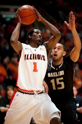 Illinois guard D.J. Richardson (1) works past Oakland (Mich.) forward Drew Valentine (15) to shoot during the first half of an NCAA college basketball game on Wednesday, Dec. 8, 2010, in Champaign, Ill. (AP Photo/Darrell Hoemann) By Darrell Hoemann