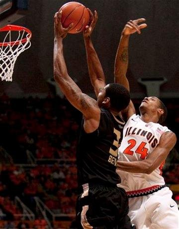 Illinois' forward Mike Davis (24) defends as Oakland (Mich.) center Keith Benson (34) shoots during the second half of an NCAA college basketball game Wednesday, Dec. 8, 2010, in Champaign, Ill. (AP Photo/Darrell Hoemann) By Darrell Hoemann