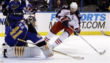 St. Louis Blues goalie Jaroslav Halak, left, of Slovakia, deflects a shot by Columbus Blue Jackets' Rick Nash during the first period of an NHL hockey game Thursday, Dec. 9, 2010, in St. Louis. (AP Photo/Jeff Roberson) By Jeff Roberson