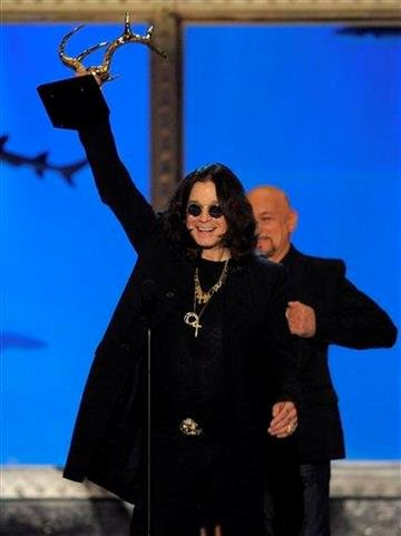 """Ozzy Osbourne accepts the award for Outstanding Literary Achievement from presenter Sir Ben Kingsley onstage at Spike TV """"Guy's Choice"""" awards in Culver City, Calif., on Saturday, June 5, 2010. (AP Photo/Chris Pizzello) By Chris Pizzello"""