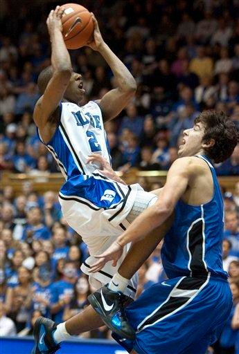 Duke's Nolan Smith, left, shoots over Saint Louis' Ellis Cody during the first half of an NCAA college basketball game in Durham, N.C., Saturday Dec. 11, 2010. (AP Photo/Lynn Hey) By LYNN HEY
