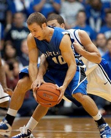 Duke player Seth Curry , right, reaches in as Saint Louis's Paul Eckerle tries to hold on during the first half of an NCAA college basketball game in Durham, N.C., Saturday Dec. 11, 2010. (AP Photo/Lynn Hey) By LYNN HEY