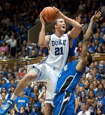 Duke's Miles Plumlee, left, shoots over Saint Louis' Dwayne Evans during the first half of an NCAA college basketball game in Durham, N.C., Saturday Dec. 11, 2010. (AP Photo/Lynn Hey) By LYNN HEY