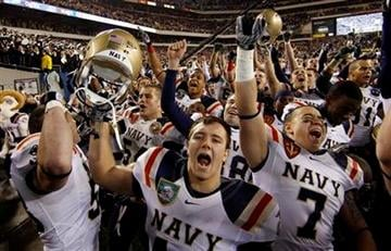 Navy's Mason Graham, center, celebrates with teammates after an NCAA college football game against Army, Saturday, Dec. 11, 2010, in Philadelphia. Navy won 31-17. (AP Photo/Matt Slocum) By Matt Slocum