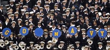 Navy midshipmen celebrate after a touchdown in the first half of an NCAA college football game against Army, Saturday, Dec. 11, 2010, in Philadelphia. (AP Photo/Matt Slocum) By Matt Slocum