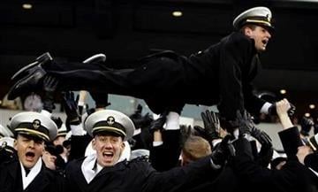 Navy Midshipmen celebrate after Navy scored a touchdown late in the second quarter of the 111th Army Navy  NCAA college football game, Saturday, Dec. 11, 2010, in Philadelphia. (AP Photo/Jacqueline Larma) By Jacqueline Larma