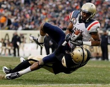 Navy wide receiver Brandon Turner, top, scores a touchdown against Army cornerback Antuan Aaron in the first half of an NCAA college football game, Saturday, Dec. 11, 2010, in Philadelphia. (AP Photo/Matt Slocum) By Matt Slocum