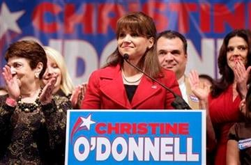 Delaware Republican Senate candidate Christine O'Donnell is surrounded by family and supporters while delivering remarks after conceding the election to opponent Democrat Chris Coons, Tuesday, Nov. 2, 2010, in Dover, Del. (AP Photo/Rob Carr) By Rob Carr