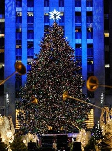 The Rockefeller Center Christmas tree stands lit during the 78th annual lighting ceremony Tuesday, Nov. 30 , 2010 in New York. (AP Photo/Stephen Chernin) By Stephen Chernin