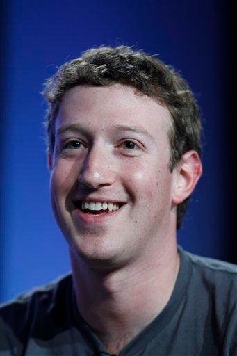 """FILE - In this Nov. 16, 2010 file photo, Facebook CEO Mark Zuckerberg smiles as he speaks at the Web 2.0 Summit in San Francisco. Zuckerberg has been named Time magazine's """"Person of the Year"""" for 2010. (AP Photo/Paul Sakuma, File) By Paul Sakuma"""