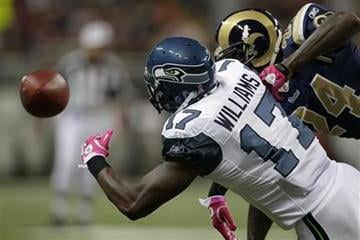 St. Louis Rams cornerback Ronald Bartell (24) breaks up a pass intended for Seattle Seahawks wide receiver Mike Williams (17) during the first quarter of an NFL football game Sunday, Oct. 3, 2010, in St. Louis. (AP Photo/Jeff Roberson) By Jeff Roberson