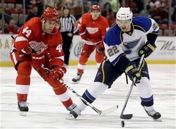 Detroit Red Wings right wing Todd Bertuzzi (44) and St. Louis Blues center Brad Boyes (22) battle for the puck in the first period of their NHL hockey game in Detroit Wednesday, Dec. 15, 2010. (AP Photo) By KMOV Web Producer