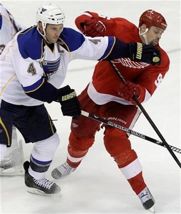 St. Louis Blues defenseman Eric Brewer (4) checks Detroit Red Wings left wing Tomas Holmstrom (96), of Sweden in the third period of their NHL hockey game in Detroit Wednesday, Dec. 15, 2010. (AP Photo) By KMOV Web Producer