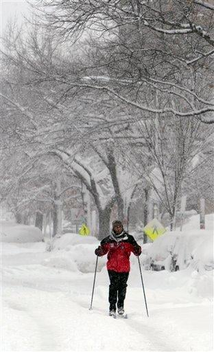 Sean McLeod, uses cross country skies as he navigates the snow covered streets of Washington, Saturday, Feb. 6, 2010. (AP Photo/Pablo Martinez Monsivais) By Pablo Martinez Monsivais