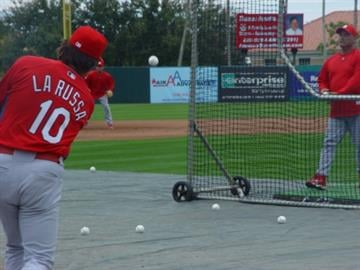 Cardinals manager Tony La Russa hits groundballs before Tuesday's game against the Minnesota Twins.