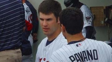 Minnesota Twins Catcher and 2009 AL MVP Joe Mauer talks with Carl Pavano during Tuesday's Cardinals/Twins game. By Lakisha Jackson