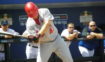 Cardinals outfielder Ryan Ludwick takes a swing in the first inning of Monday's Mets-Cardinals game. By Lakisha Jackson