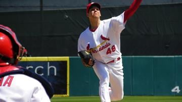Cardinals pitcher Rich Hill throws a pitch during warm-ups of Thursday's Braves-Cardinals game By Lakisha Jackson